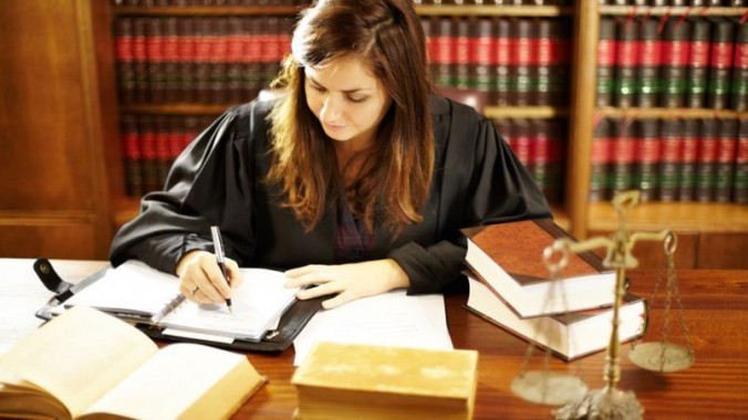 Attractive young judge sitting at her desk working